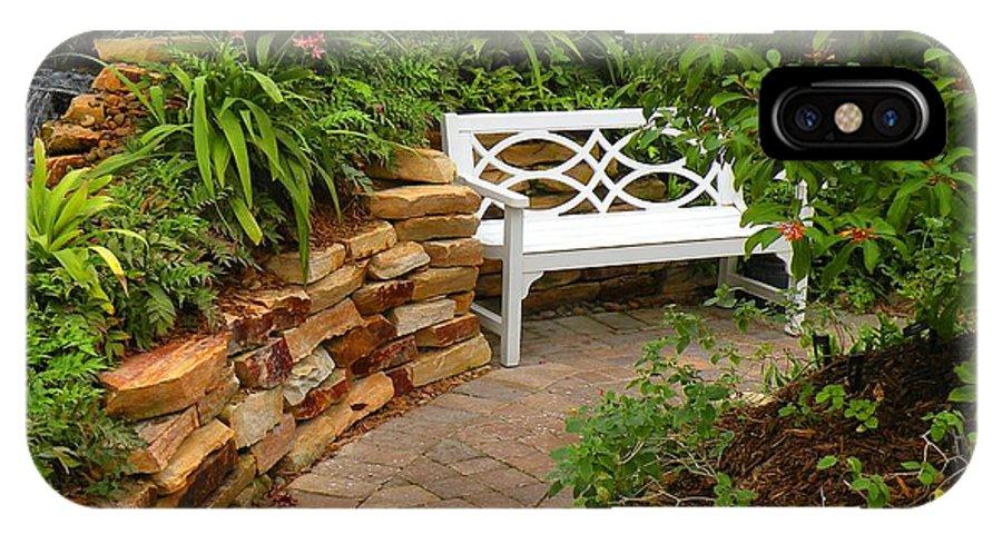 Garden IPhone X Case featuring the photograph White Bench In The Garden by Rosalie Scanlon
