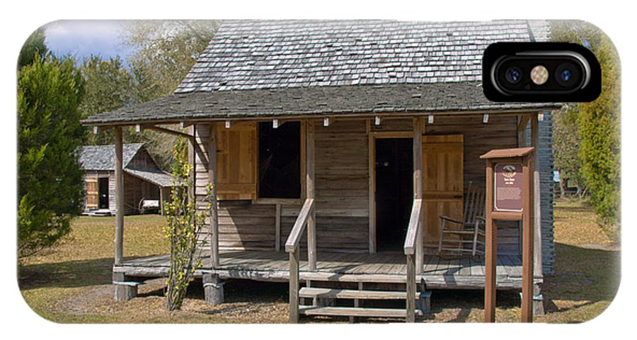 Cabin IPhone X Case featuring the photograph Yates Homestead Built In 1893 On Taylor Creek In Central Florida by Allan Hughes