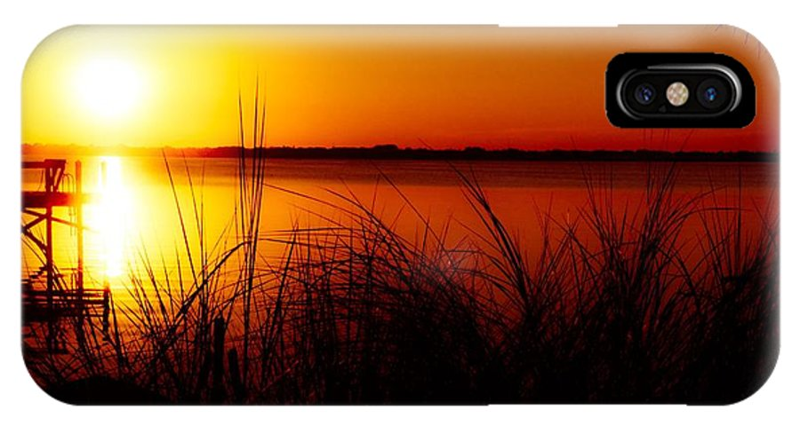 Sun IPhone X Case featuring the photograph Yellow Sets on Red by Eddy Mann