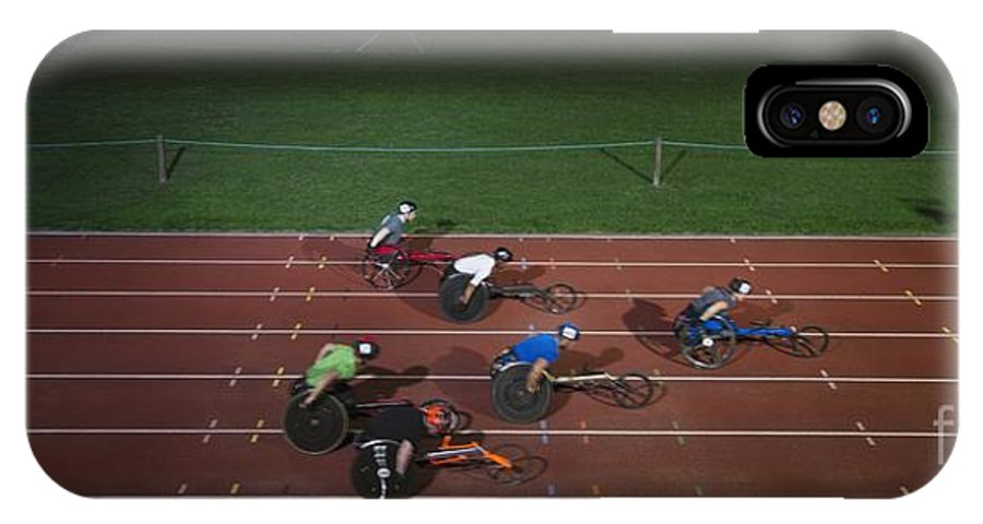 14-15 Years IPhone X Case featuring the photograph Paraplegic Athletes Racing Along Sports Track In Night by Caia Image/science Photo Library