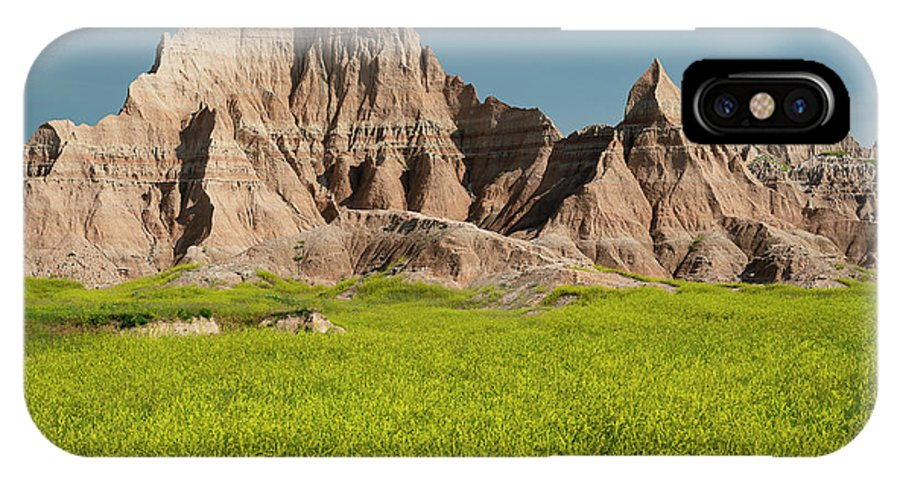 North America IPhone X Case featuring the photograph Badlands by Christian Heeb