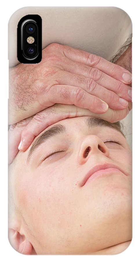 Adolescence IPhone X Case featuring the photograph Teenage Boy Laying On A Massage Table by Ben Gingell