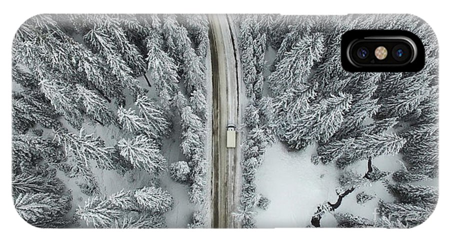 Country IPhone X Case featuring the photograph Aerial View Of A Snowy Forest With High by Omphoto