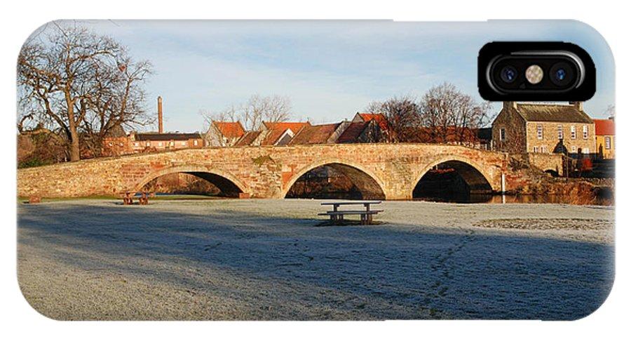 Bridge IPhone X Case featuring the photograph bridge over river Tyne in Haddington in winter by Victor Lord Denovan