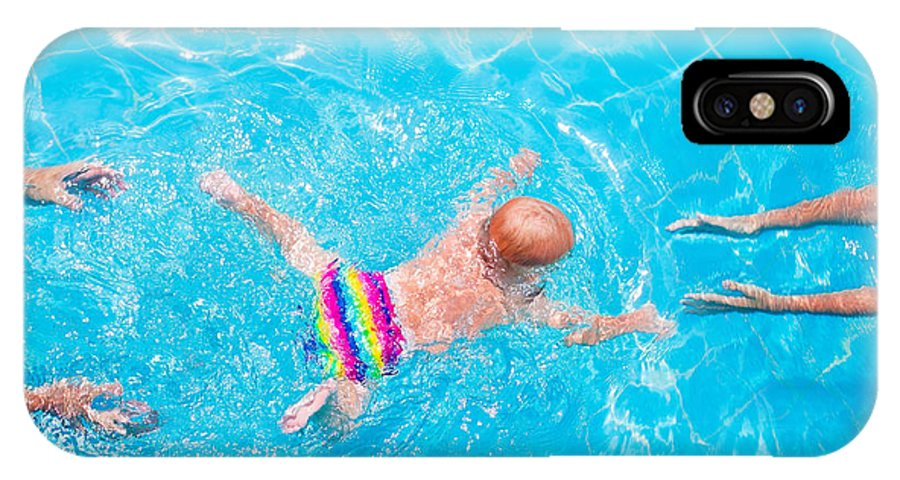 Play IPhone X Case featuring the photograph Cute Little Baby Swimming Underwater by Famveld