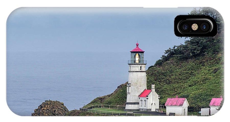 Heceta Head Lighthouse IPhone X Case featuring the photograph Heceta Head Lighthouse by Jurgen Lorenzen