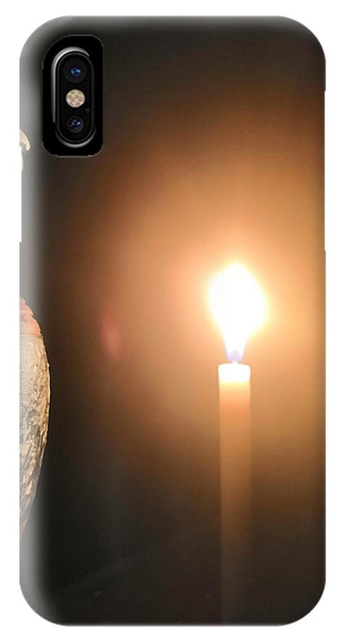 Candle Light IPhone X Case featuring the photograph Light In The Dark by Ian Batanda