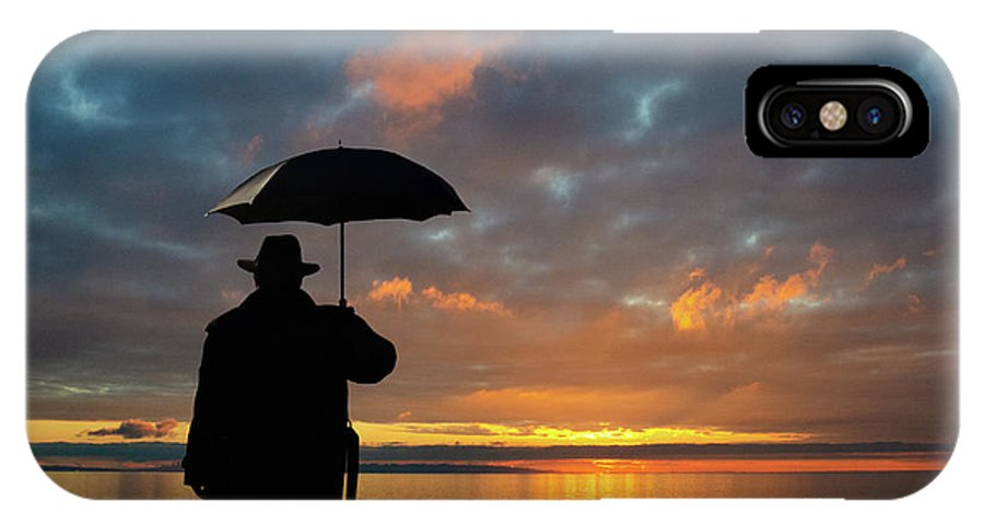 Sun IPhone X Case featuring the photograph On The Edge Of Time by Bob Christopher