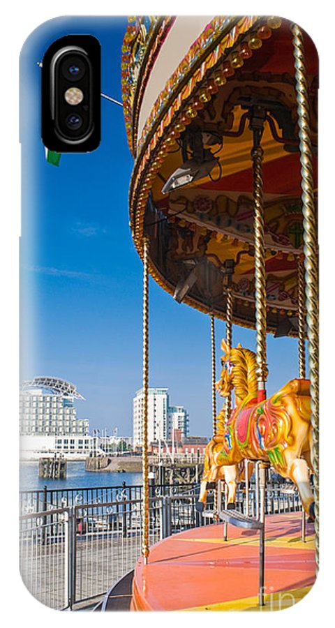 Capital IPhone X Case featuring the photograph Pretty Carousel Overlooking Slick by Matthew Dixon