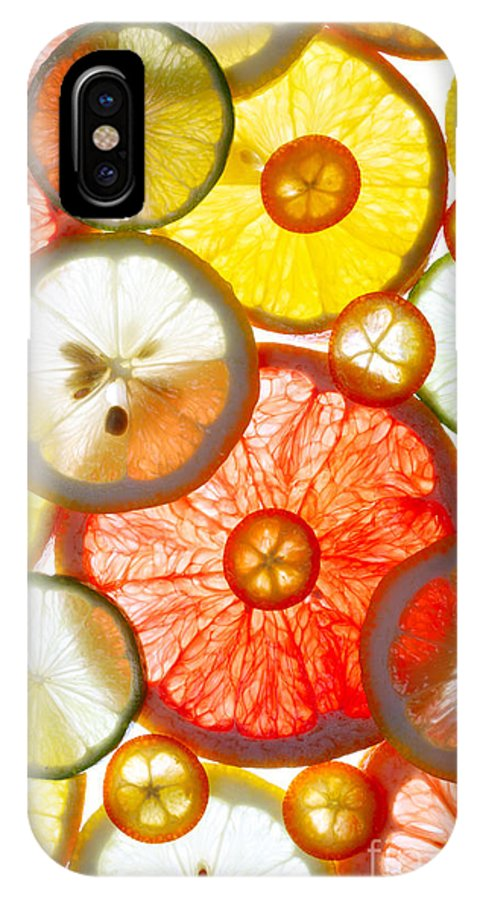 Color IPhone X Case featuring the photograph Sliced Citrus Fruits Background by Gaak