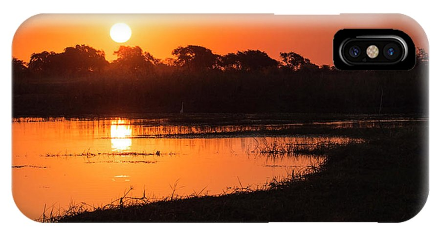 Sunset IPhone X Case featuring the photograph Sunset On The Chobe River by Claudio Maioli