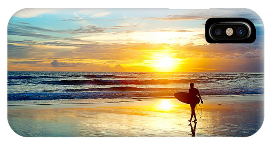 Southern IPhone X Case featuring the photograph Surfer On The Ocean Beach At Sunset On by Joyfull