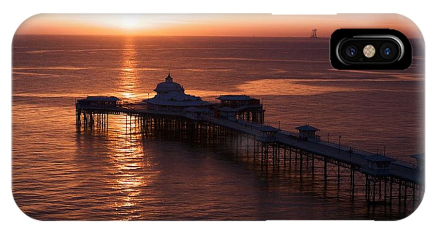 Piers IPhone X Case featuring the photograph Sunrise over Llandudno pier 2 by Christopher Rowlands