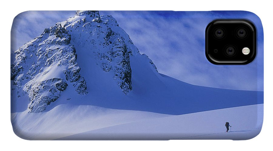 Adventure IPhone Case featuring the photograph A Woman Ski Tours And Explores by Jimmy Chin