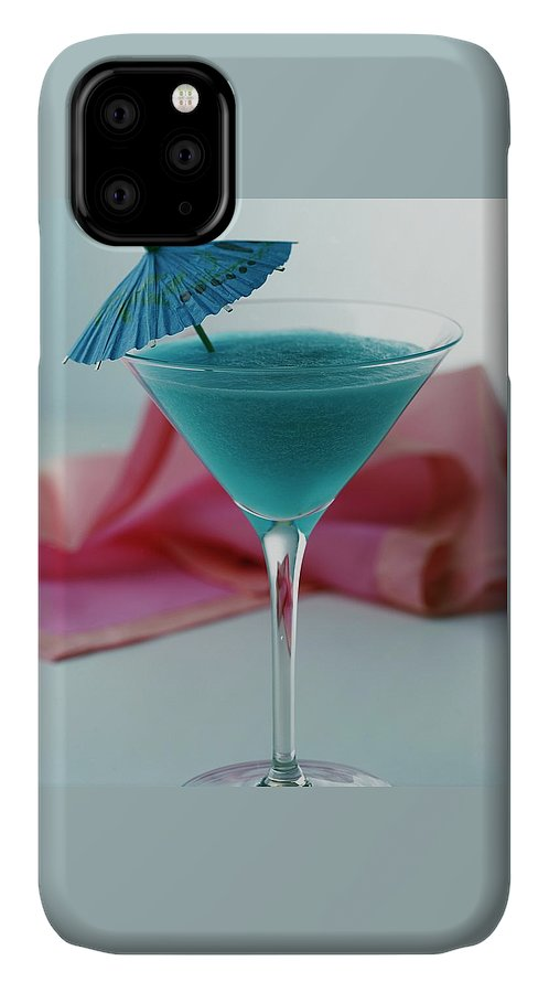 Beverage IPhone Case featuring the photograph A Blue Hawaiian Cocktail by Romulo Yanes