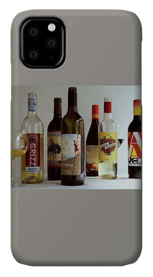 Food IPhone 11 Case featuring the photograph A Collection Of Wine Bottles by Romulo Yanes