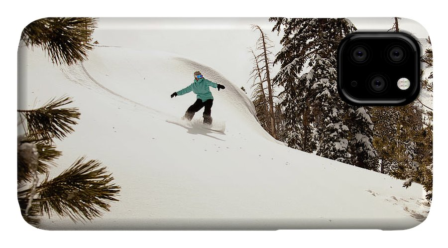 California IPhone 11 Case featuring the photograph A Female Snowboarder Lays Out Some by Kyle Sparks