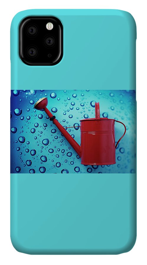Home IPhone Case featuring the photograph A Red Watering Can by Romulo Yanes