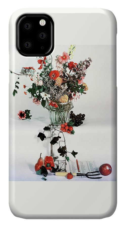 Nobody IPhone 11 Case featuring the photograph A Studio Shot Of A Vase Of Flowers And A Garden by Herbert Matter