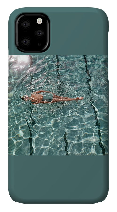 Water IPhone Case featuring the photograph A Woman Swimming In A Pool by Fred Lyon