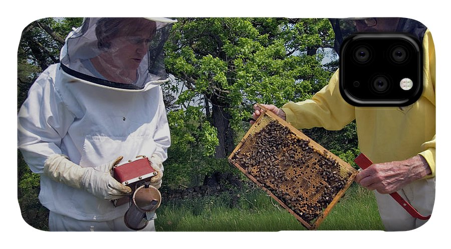 Apis Mellifera IPhone Case featuring the photograph Beekeepers Inspecting A Beehive by Simon Fraser/science Photo Library