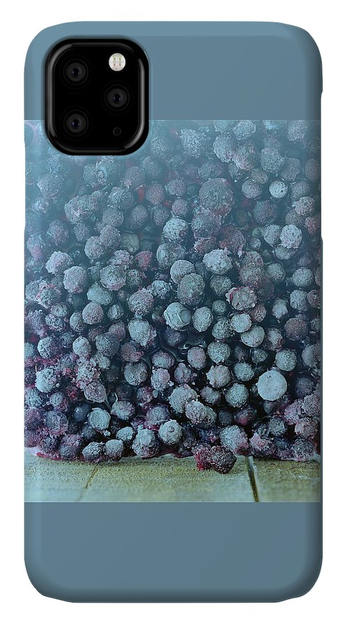 Berries IPhone Case featuring the photograph Frozen Blueberries by Romulo Yanes