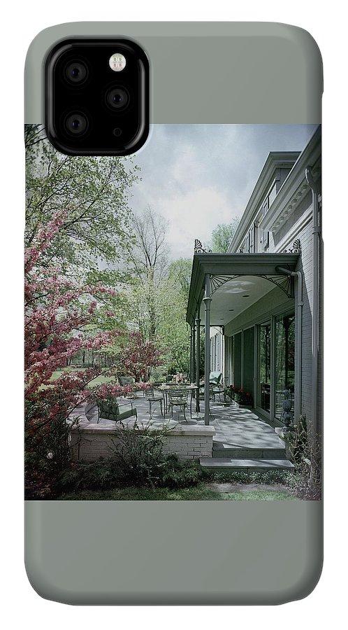 Garden IPhone Case featuring the photograph Hollis Baker's Patio by Pedro E. Guerrero