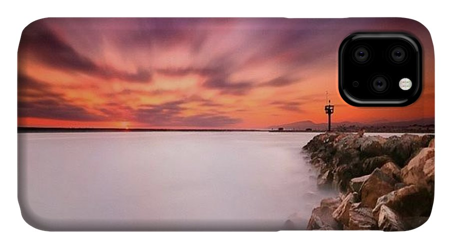 IPhone Case featuring the photograph Long Exposure Sunset Shot At A Rock by Larry Marshall