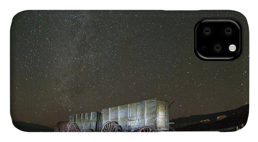 America IPhone Case featuring the photograph Wagon Train Under Night Sky by Juli Scalzi