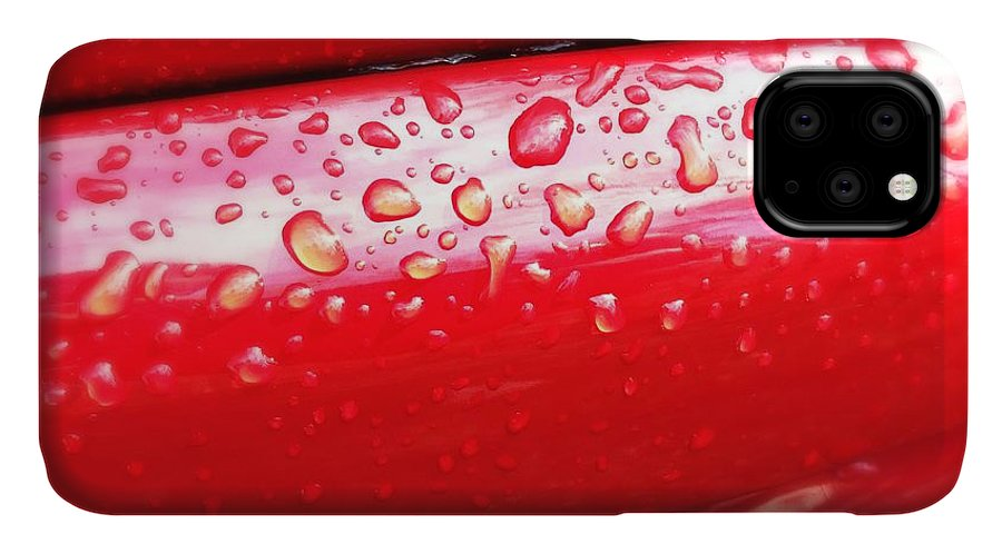 Drops IPhone Case featuring the photograph Water drops on red car paint by Matthias Hauser