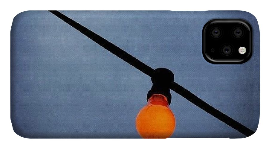 Orange IPhone Case featuring the photograph Orange Light Bulb by Matthias Hauser