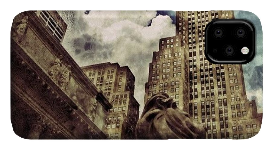 Building IPhone Case featuring the photograph The resting Lion - NYC by Joel Lopez