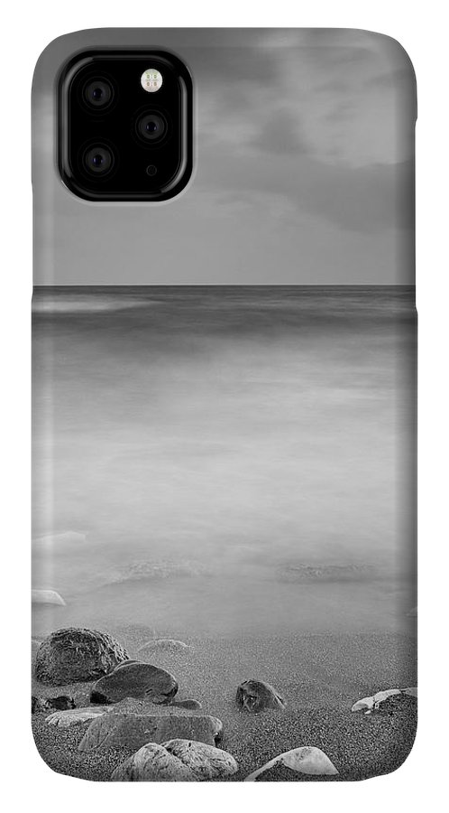 Water IPhone Case featuring the photograph Black Stones by Guido Montanes Castillo