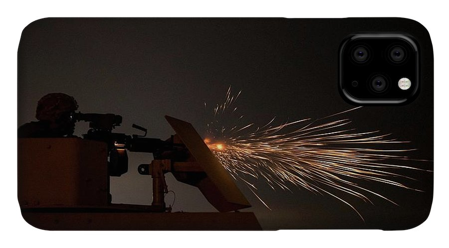 Military IPhone Case featuring the painting A U.s. Army Reserve Military Police Soldier, Fires An M249 Squad Automatic Weapon by Celestial Images