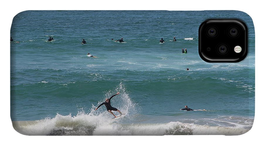 Catching A Wave IPhone Case featuring the photograph Catching Air in Huntington Beach California by Colleen Cornelius