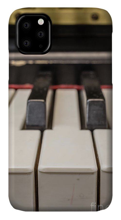 Black IPhone Case featuring the photograph Close Up Of Keys On A Piano by Edward Fielding