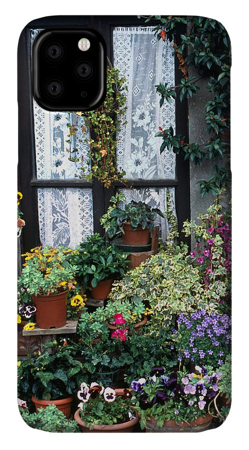 Color Photograph IPhone Case featuring the photograph Mama's Flowers Tuscany Italy by Dan Albright