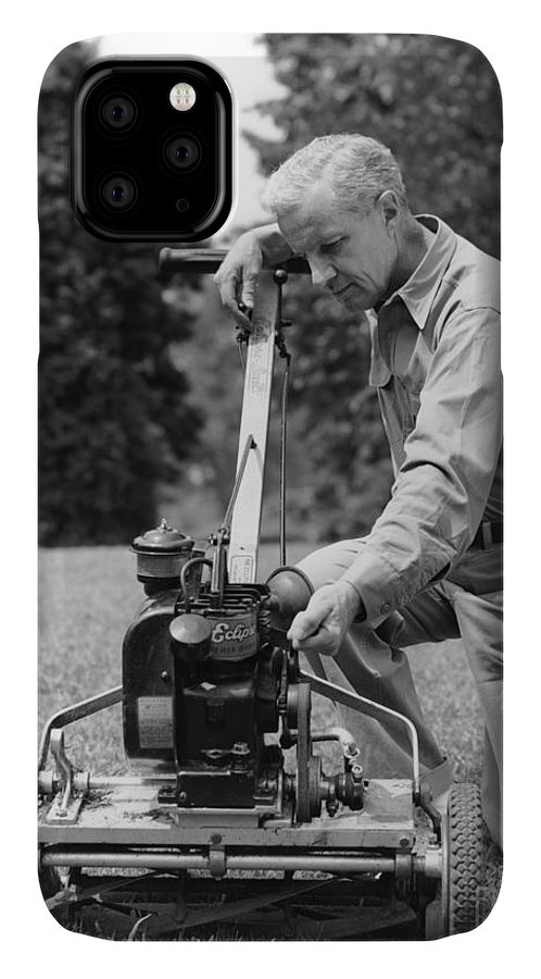 1940s IPhone Case featuring the photograph Man Tinkering With Lawnmower, C.1940s by H. Armstrong Roberts/ClassicStock
