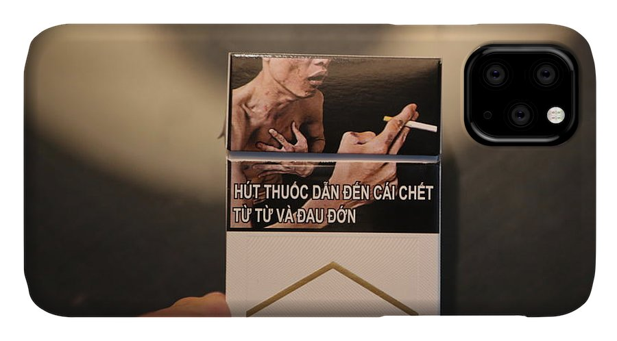 Vietnam IPhone Case featuring the photograph Marlboro Cigarettes Pkg Vietnam by Chuck Kuhn