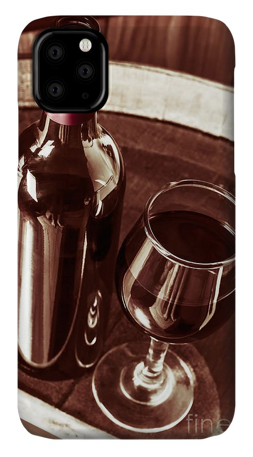 Bottle IPhone Case featuring the photograph Old Wine Bottle And Glass In Rustic Wine Cellar by Jorgo Photography - Wall Art Gallery