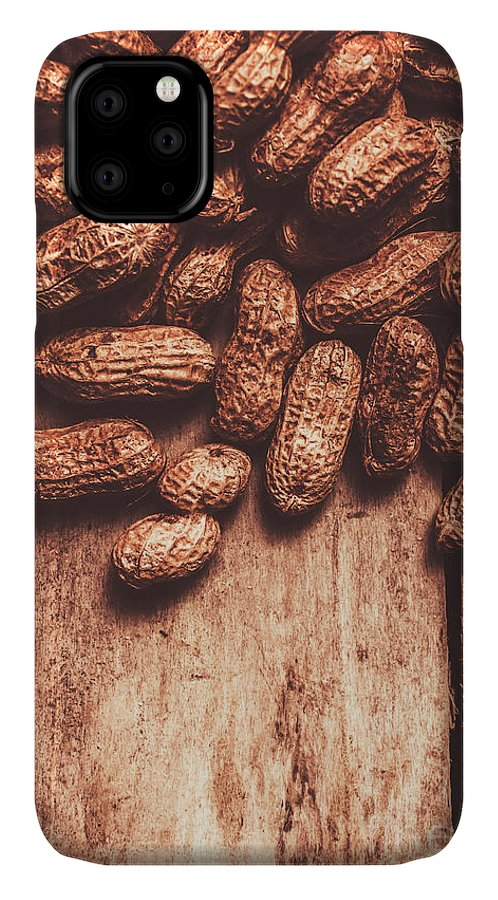 Kitchen IPhone Case featuring the photograph Pile Of Peanuts Covering Top Half Of Board by Jorgo Photography - Wall Art Gallery
