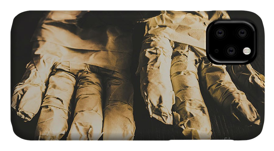 Nightmare IPhone 11 Case featuring the photograph Rising Mummy Hands In Bandage by Jorgo Photography - Wall Art Gallery