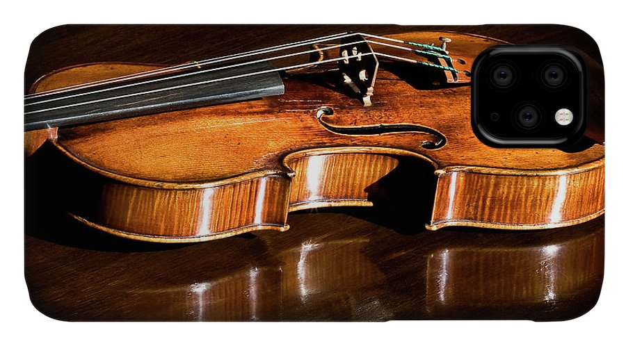 Strad IPhone Case featuring the photograph Stradivarius In Sunlight by Endre Balogh