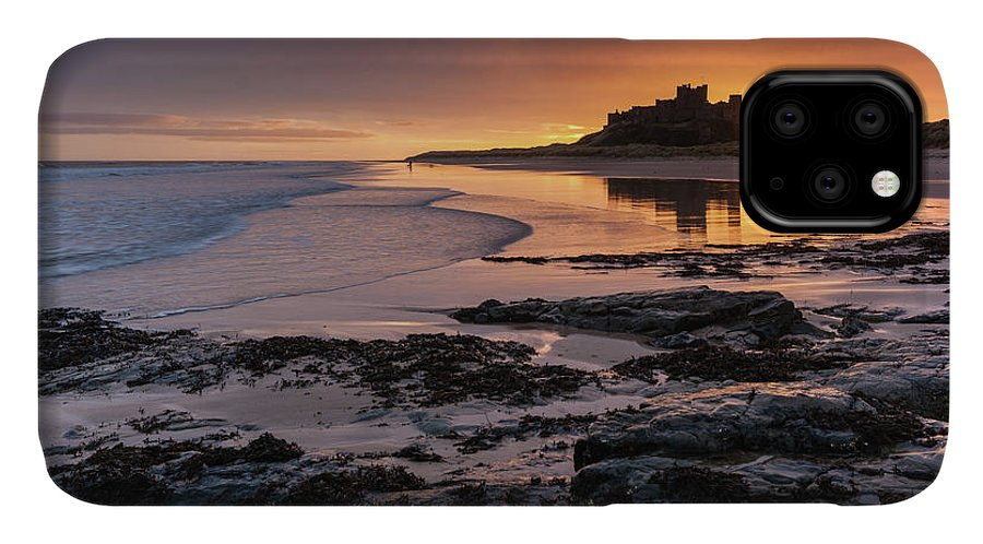 Sunrise IPhone Case featuring the photograph Sunrise at Bamburgh Castle #4, Northumberland, North East England by Anthony Lawlor