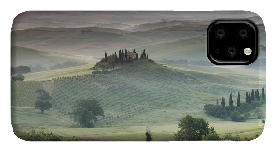 View Of The Countryside With The Belvedere In The Distance (photo) Landscape; Italian; Tuscan; Tuscany; Rural; Val D'orcia; Villa; Spring; Scenic; Atmospheric; Hilltop; Building; Architecture; Exterior; Remote; Isolated; Cloud IPhone 11 Case featuring the photograph Tuscany by Tuscany