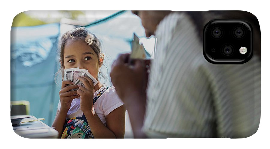 40-44 Years IPhone Case featuring the photograph Mother And Daughter Playing Card Game by Caia Image/science Photo Library