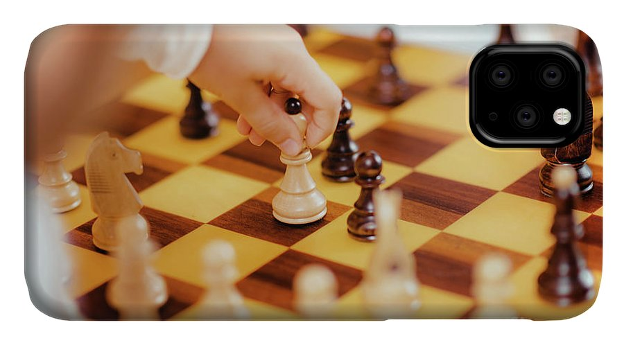 Chess IPhone Case featuring the photograph Two Boys Playing Chess by Microgen Images/science Photo Library