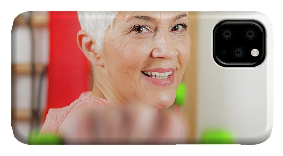 Senior IPhone Case featuring the photograph Senior Woman Exercising 3 by Microgen Images/science Photo Library