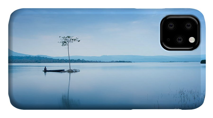 Beauty IPhone Case featuring the photograph A Man Fishing On The Boat Near The by Worradirek