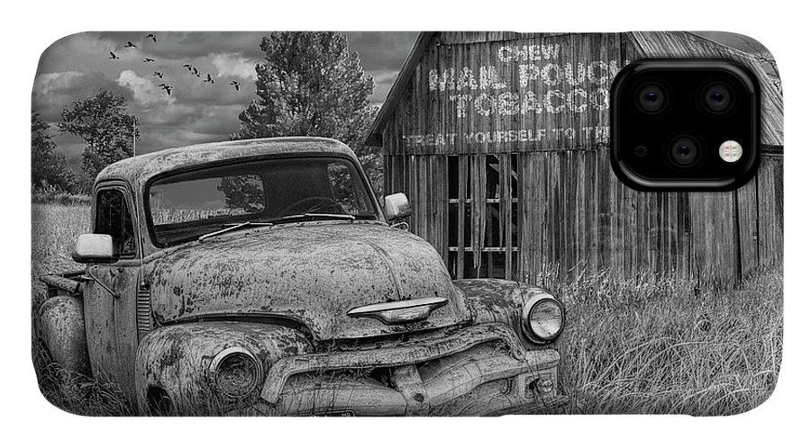 Chevy IPhone Case featuring the photograph Black And White Of Rusted Chevy Pickup Truck In A Rural Landscape By A Mail Pouch Tobacco Barn by Randall Nyhof